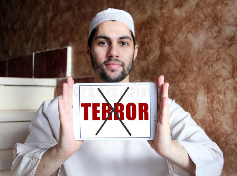 No terror. On white tablet holded by smiling arab religious muslim man royalty free stock photography