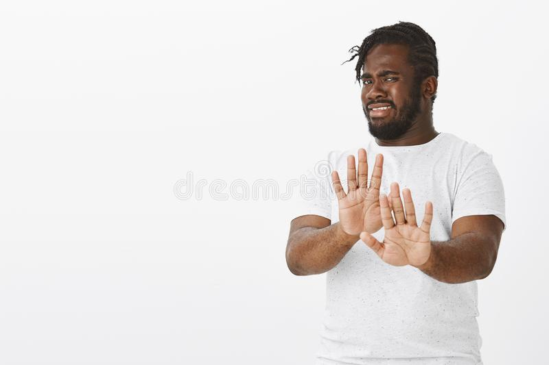 No thanks, I refuse. Portrait of displeased intense attractive african-american man with beard and moustache, pulling. Palms towards camera in stop or rejection stock images