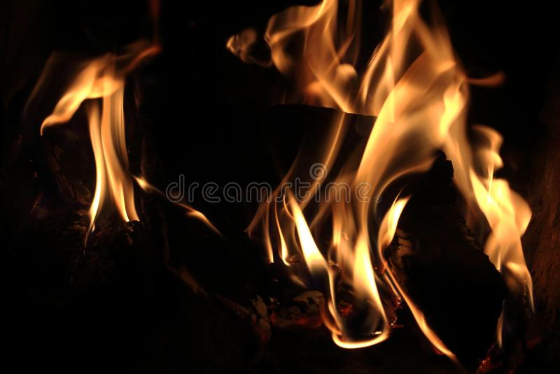 Языки пламени. Огонь горящий в камине. No, there`s nothing more stock image