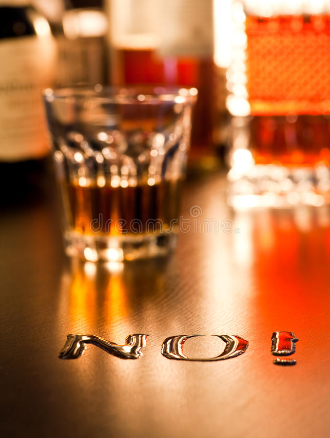 No to Alcohol. The word No written with spoiled whiskey on a table, shallow DOF royalty free stock photos