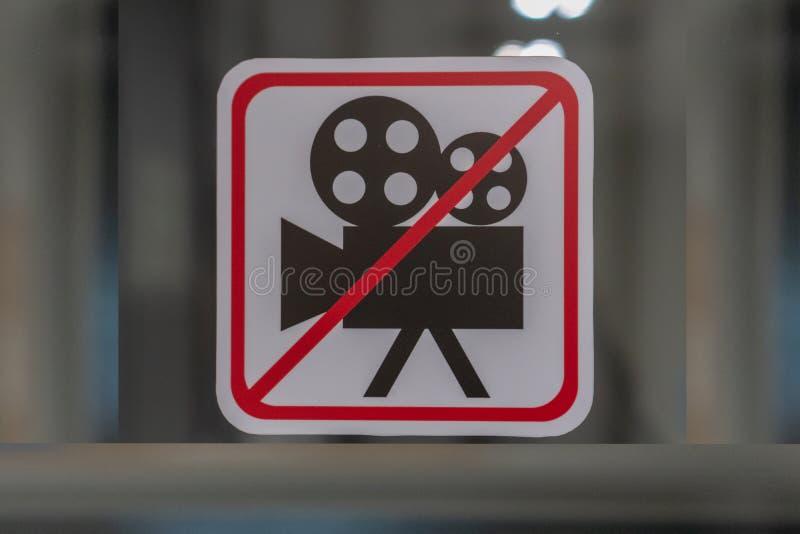 No tome la muestra de las fotos muestra ningún vídeo permitido en fondo gris imagen de archivo
