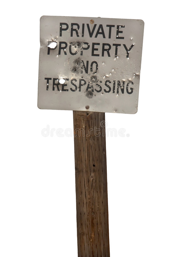 No trespasing sign with bullet holes