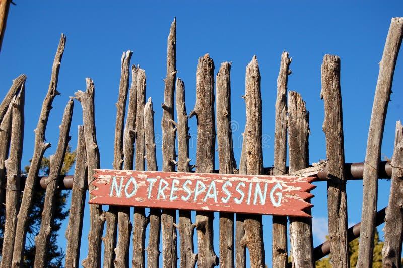 No Trespassing. Handmade no trespassing sign hanging on a fence post stock photo