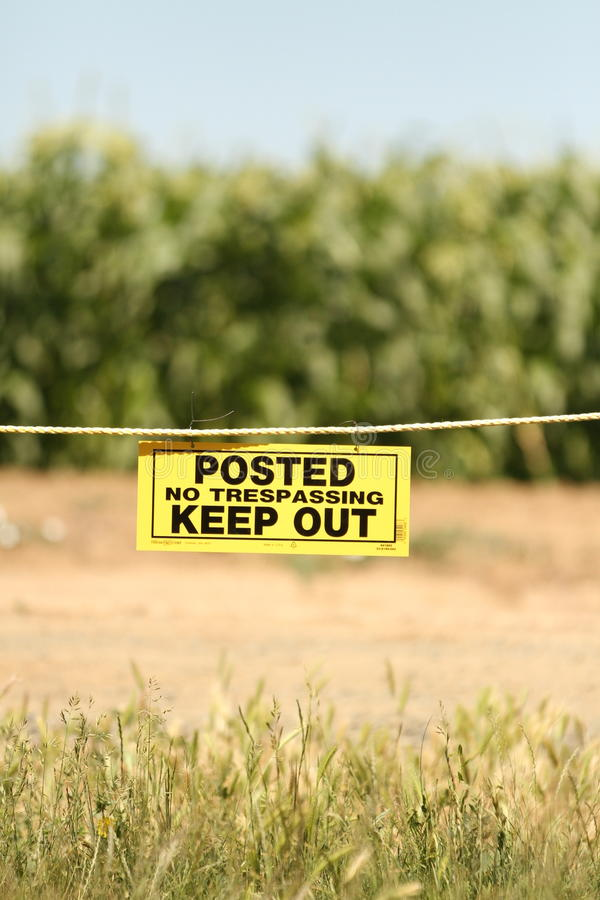 No Trespassing Sign in front of a orchard royalty free stock photos