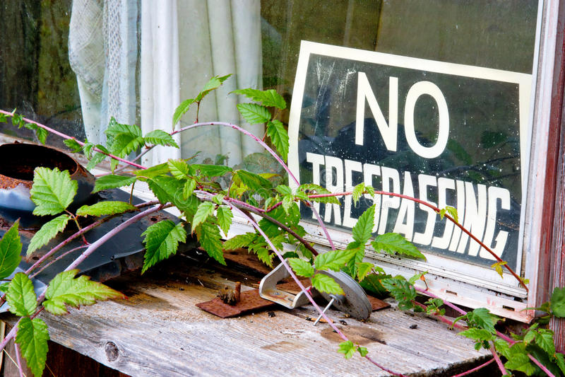 No trespassing sign at window stock photo