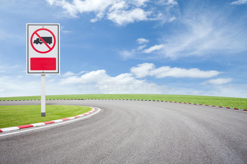 No truck allowed sign on asphalt road with green grass sky background. No truck allowed sign on asphalt road with green grass sky background royalty free stock photo