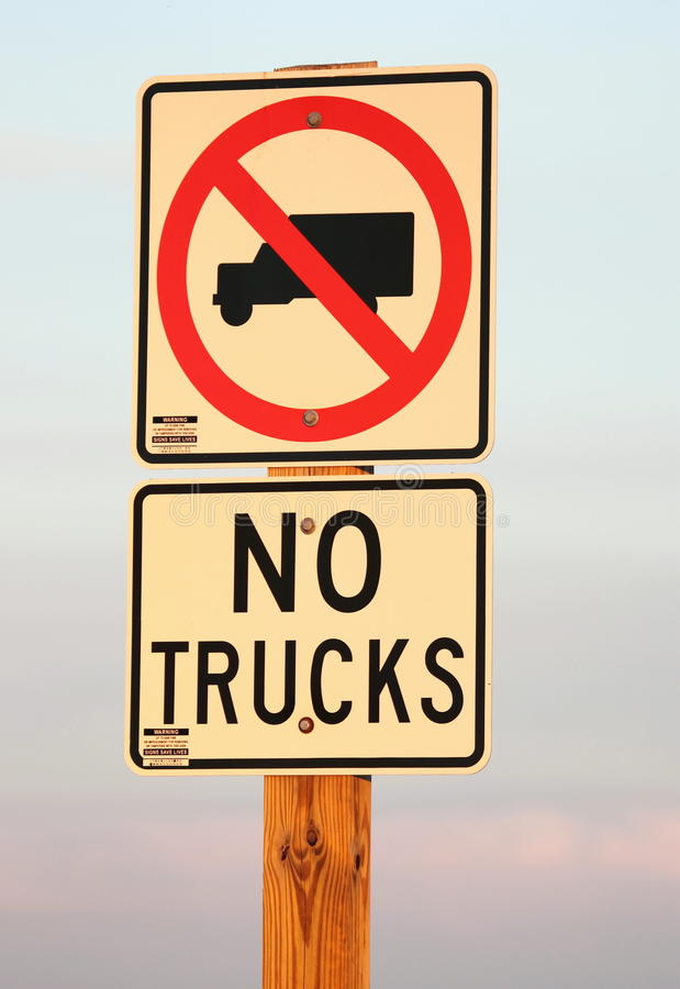No Trucks Allowed Sign. A road sign showing no trucks are allowed royalty free stock photo