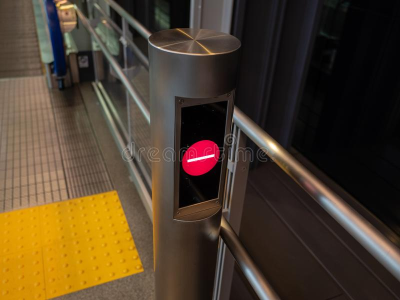 No walk sign in front of the escalator in airport terminal. No walk sign in front of the escalator royalty free stock photo