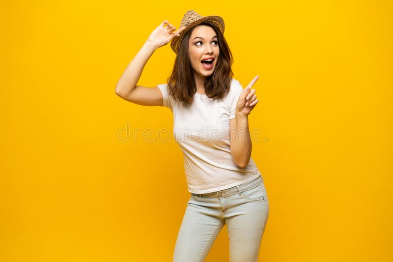 No way, look this ! Woman pointing finger at copy space. Expression emotion and feelings concept. Studio shot, isolated royalty free stock photography