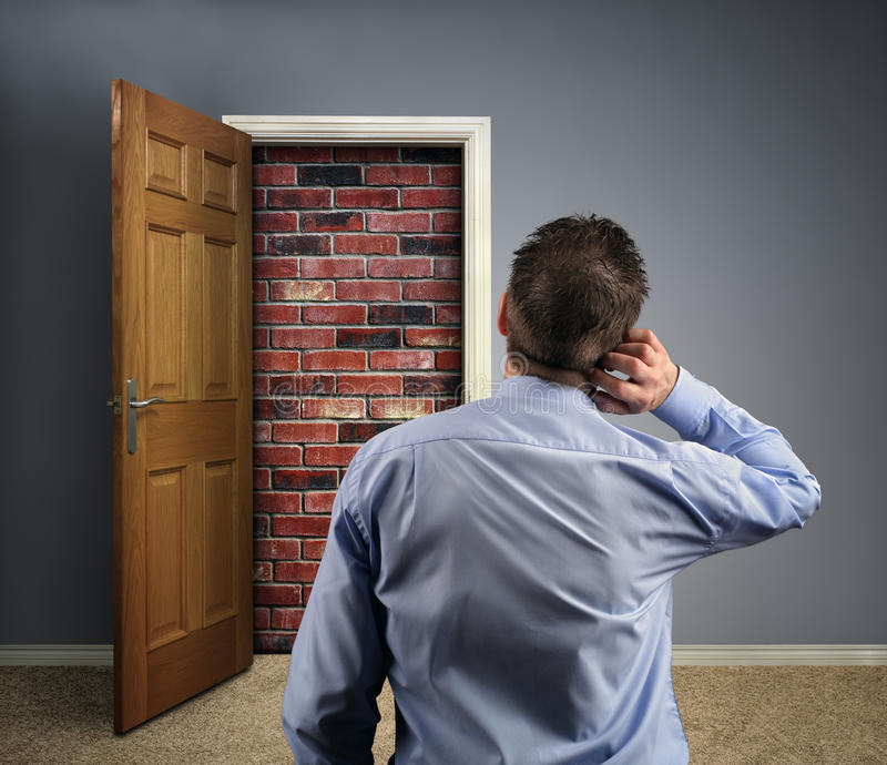 No way out. Brick wall blocking the office doorway for a businessman concept for conquering adversity, business obstacle trapped or no way out royalty free stock photos