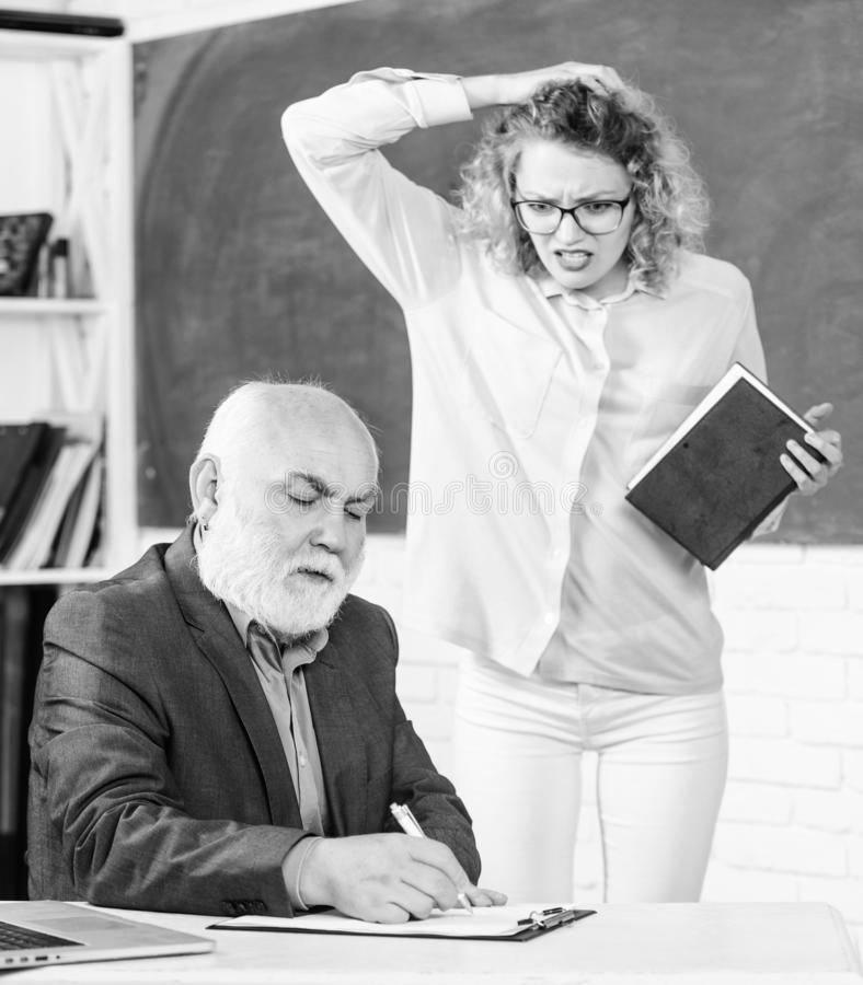 No way. senior teacher and woman at school lesson. student girl with tutor man at blackboard. student and tutor with. No way. senior teacher and women at school royalty free stock photo