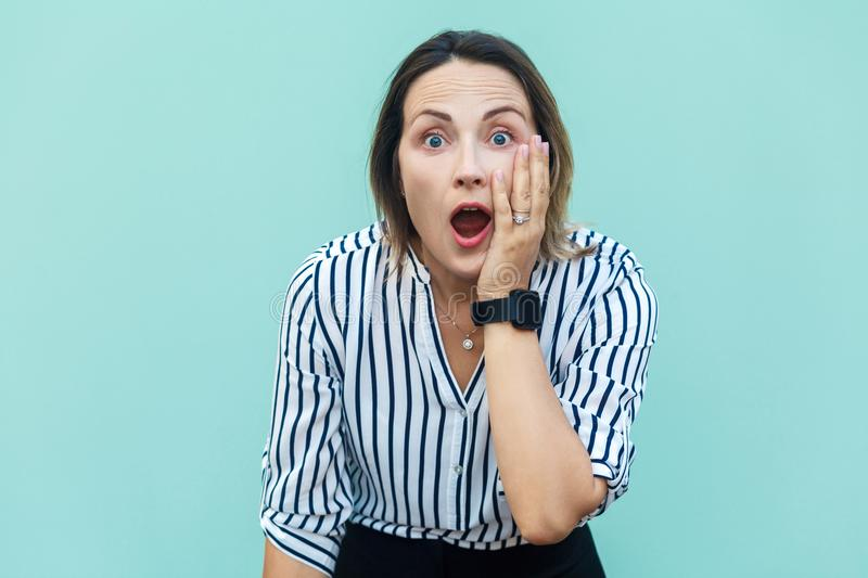 No way! Surprised business woman lady with opened mouth and big stock photo