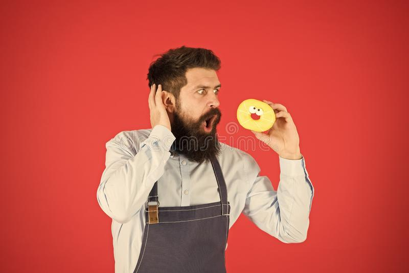 No way. True facts about sugar. Hipster bearded baker hold glazed donut on red background. Cafe and bakery concept. Sweet donut from baker. Man bearded baker stock images