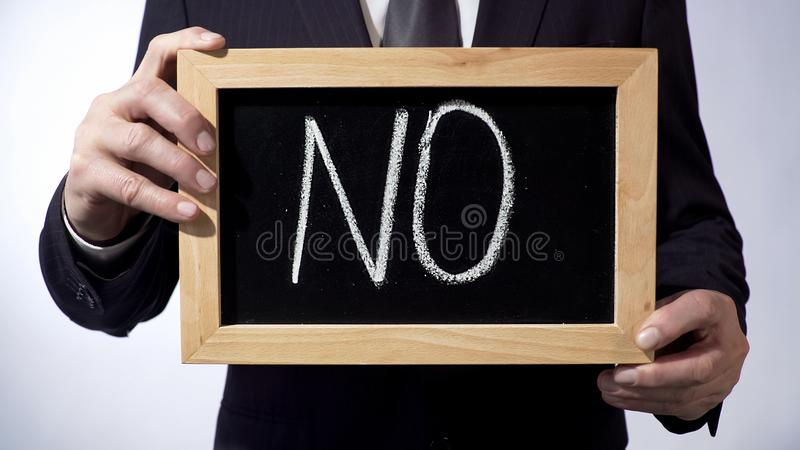 No written on blackboard, businessman holding sign, calling to stop corruption royalty free stock photography
