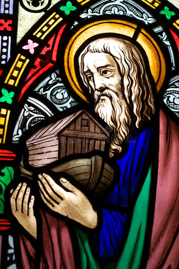 Noah 2. Detail of victorian stained glass church window in Fringford depicting Noah with the ark in his arms royalty free stock photography