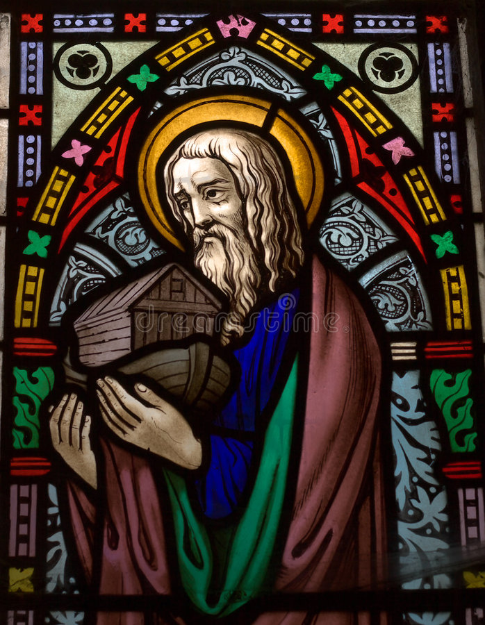 Noah. Detail of victorian stained glass church window in Fringford depicting Noah with the ark in his arms royalty free stock photo