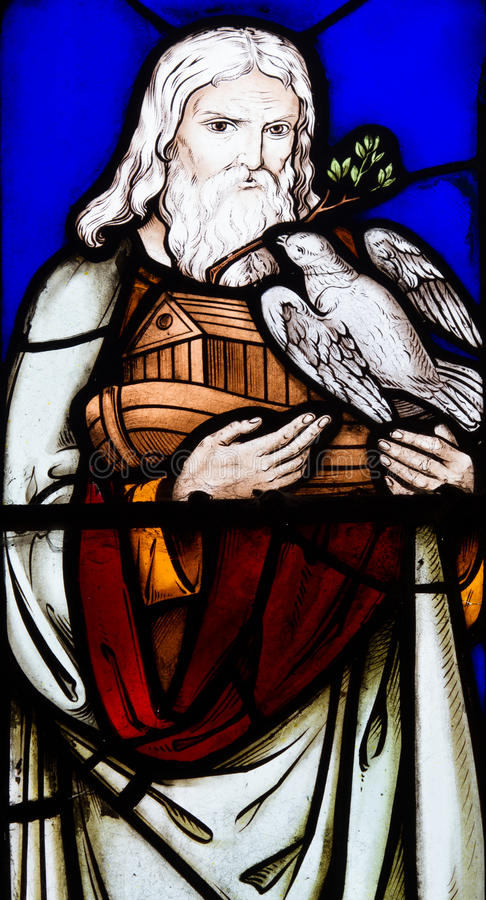 Noah carrying the ark. A stained glass window showing Noah carrying the Ark with a white dove royalty free stock photo