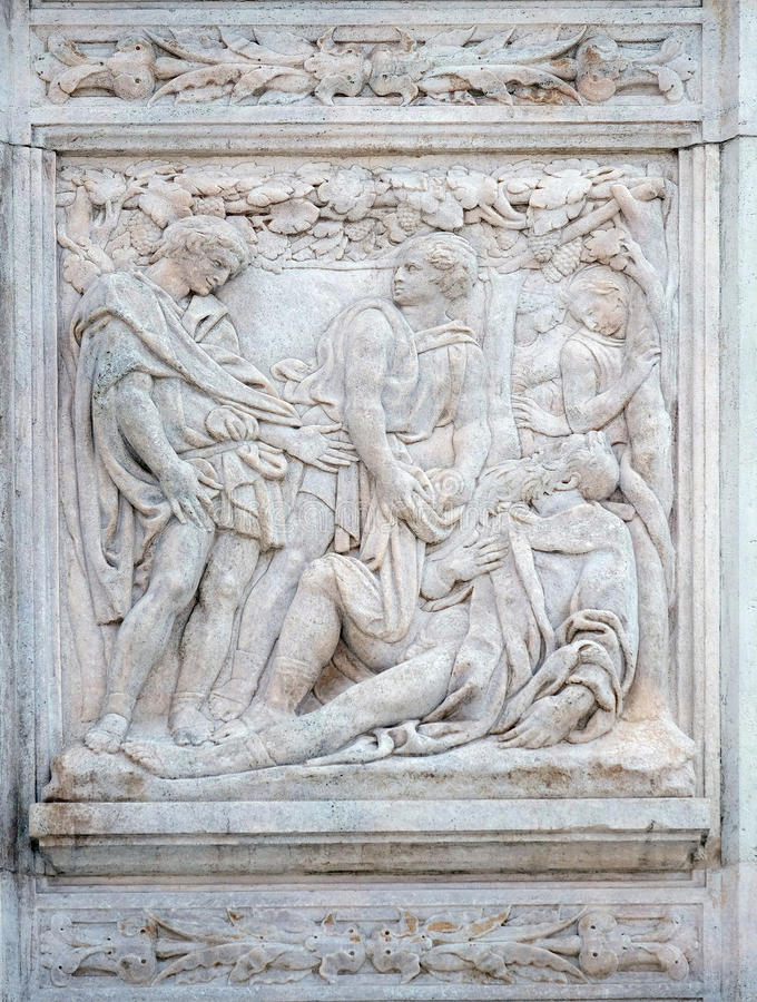 The Noah elation. Relief on portal of Saint Petronius Basilica in Bologna, Italy royalty free stock image