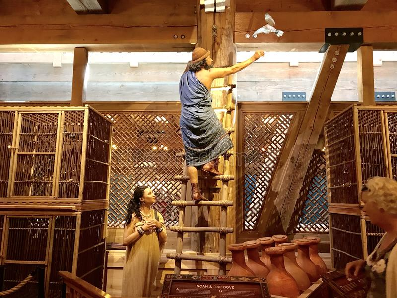 Noah Releasing the Dove on the Ark in the Ark Encounter Theme Park. Williamstown, KY, USA - November 3, 2017: Noah releasing the dove on Noah`s ark replica at royalty free stock photography