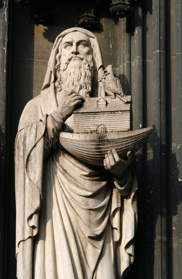 Noah's Ark. A gothic statue oh Noah with the Noah's Ark in his hands on the facade of the Cologne Cathedral in Cologne, Germany stock photo