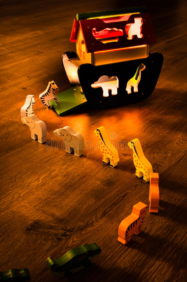 Noahs Ark at Night. A row of animals going into the safety of the Noahs Ark no matter day or night stock photos