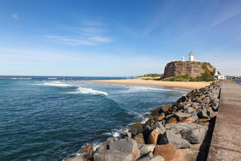 Nobbys Lighthouse and beach - Newcastle Australia. Nobbys Lighthouse is one of Newcastle`s most famous landmarks. The lighthouse dates from the 19th century and stock photos