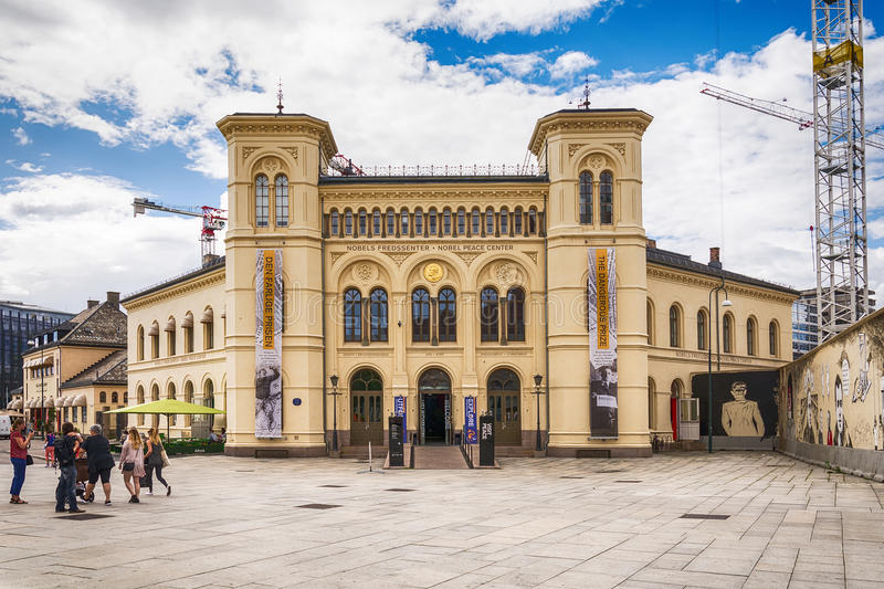 Nobel Peace Center in Oslo. Oslo, Norway - July 18, 2016: Nobel Peace Center in Oslo, autumn afternoon. Some people walking over square, some sitting in café stock photography