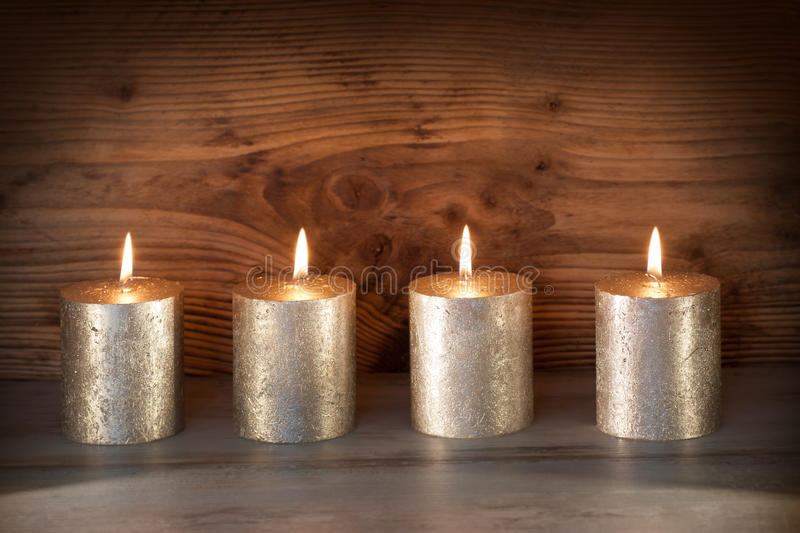 Noble candles against a background of wood royalty free stock photos