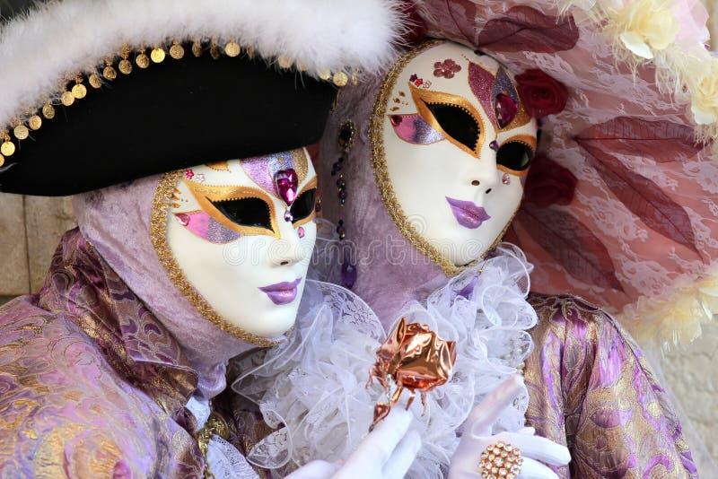 Noble and elegant couple masked royalty free stock photo
