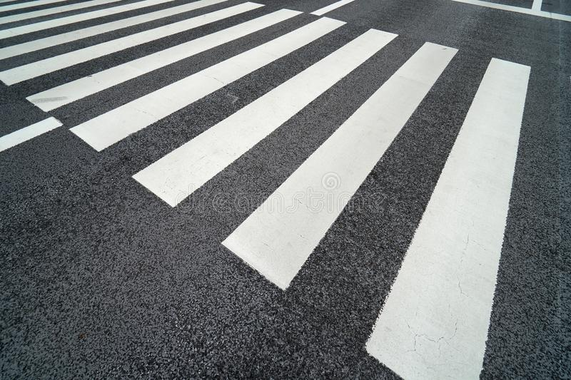 Nobody on Crosswalk in Black and white Crosswalk. It is for pedestrians across the street. For safety On the day in the fall Dark stock photo