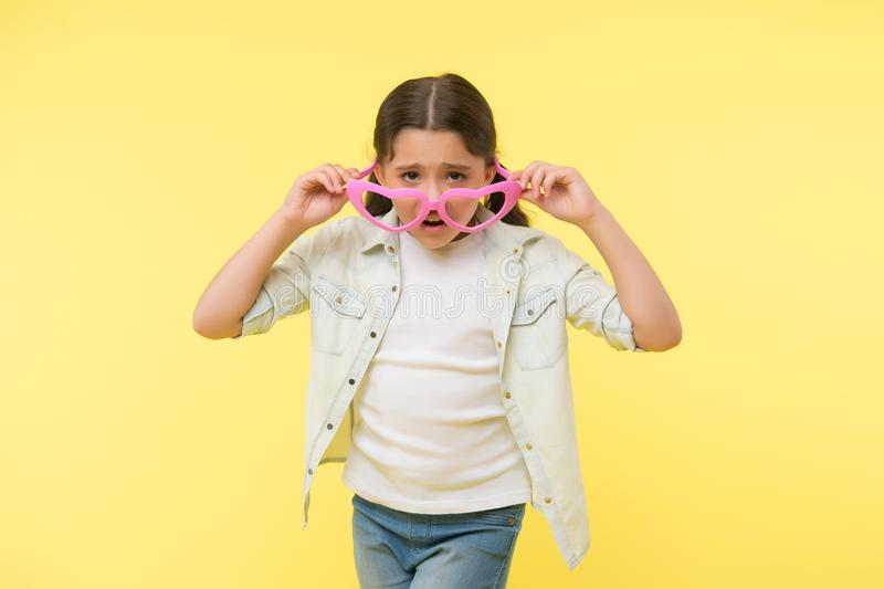Nobody likes me. Kid girl unhappy face takes off heart shaped eyeglasses. Girl feels lonely and unhappy. Everyone. Deserves to be loved and happy. Offended stock images