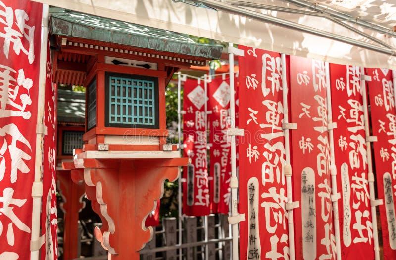 Nobori red banners at shrine, Osaka, Japan.  royalty free stock image