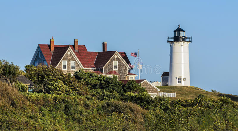 Nobska Lighthouse Cape Cod Massachusetts. Nobska Lighthouse, Woods Hole, Falmouth, Cape Cod, Massachusetts USA. This Cape Cod landmark is a white cast-iron tower royalty free stock image