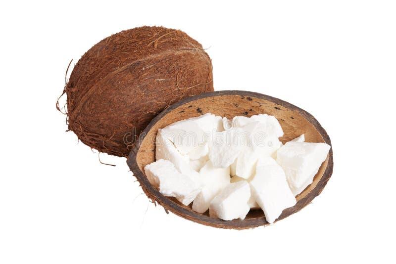 Noce di cocco ed olio di noce di cocco isolato su bianco fotografie stock libere da diritti