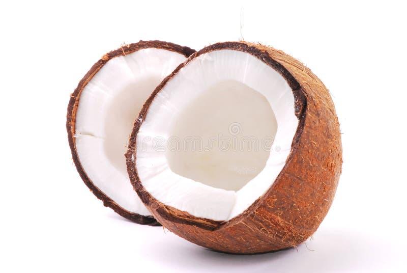 Noce di cocco rotta immagini stock