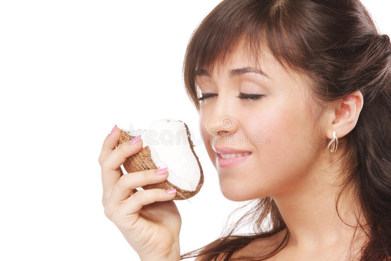 Noce di cocco sentente l'odore del Brunette fotografia stock libera da diritti