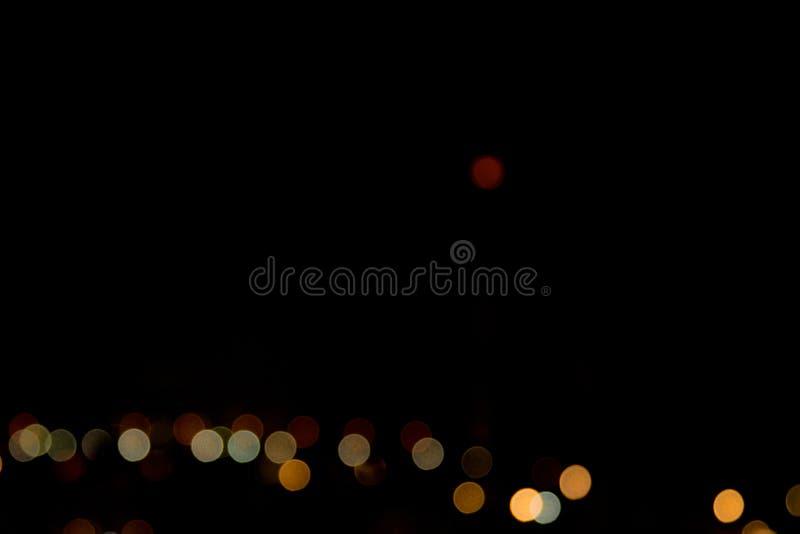 Noche abstracta del bokeh en ciudad imagenes de archivo