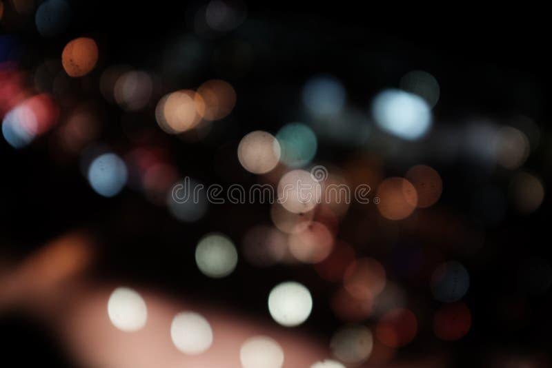 Noche ligera en el fondo del extracto de la falta de definición del bokeh de la ciudad fotografía de archivo