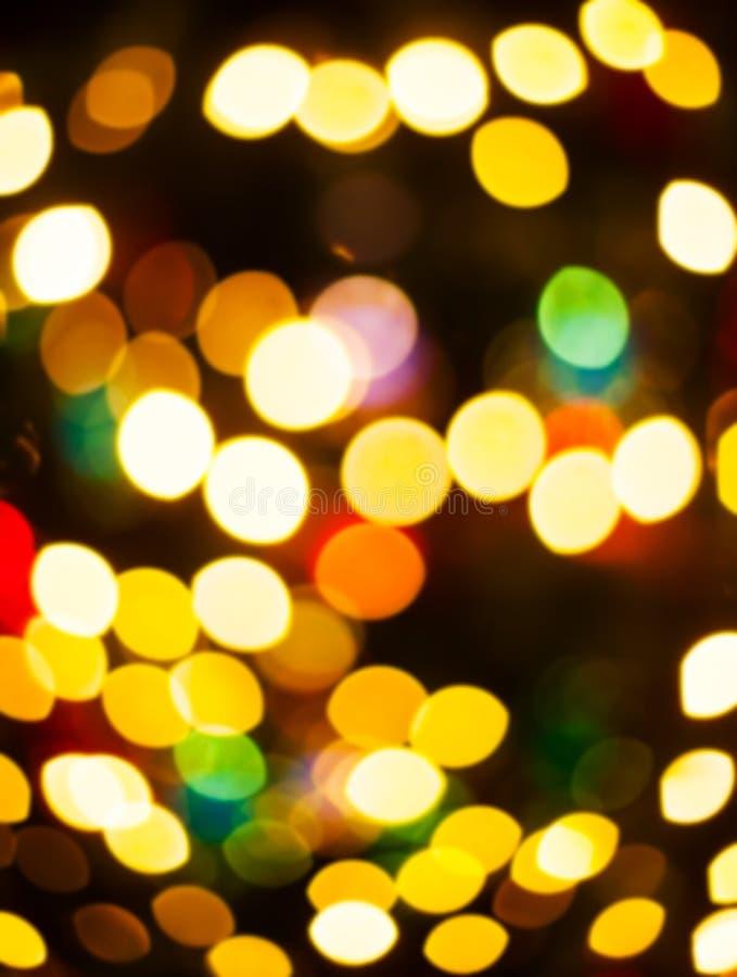 Nochebuena, fondo borroso bokeh de las luces de la decoración del Año Nuevo fotos de archivo