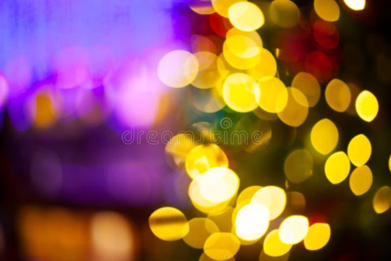 Nochebuena, fondo borroso bokeh de las luces de la decoración del Año Nuevo foto de archivo