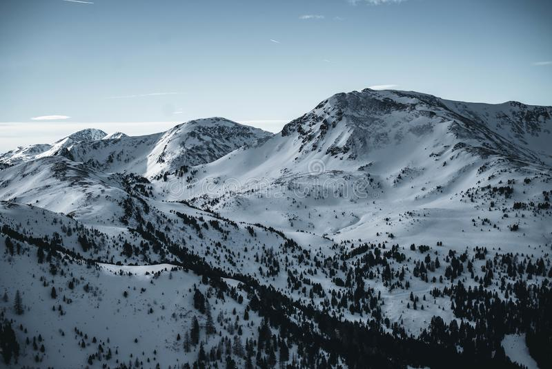 Nocky mountains in Austria getting covered in shaddow. Winter Alps during sunset. stock photography