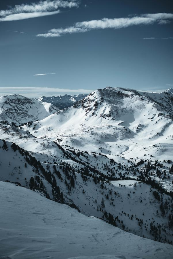 Nocky mountains in austrian Alps photographed from a slope in February. stock photography