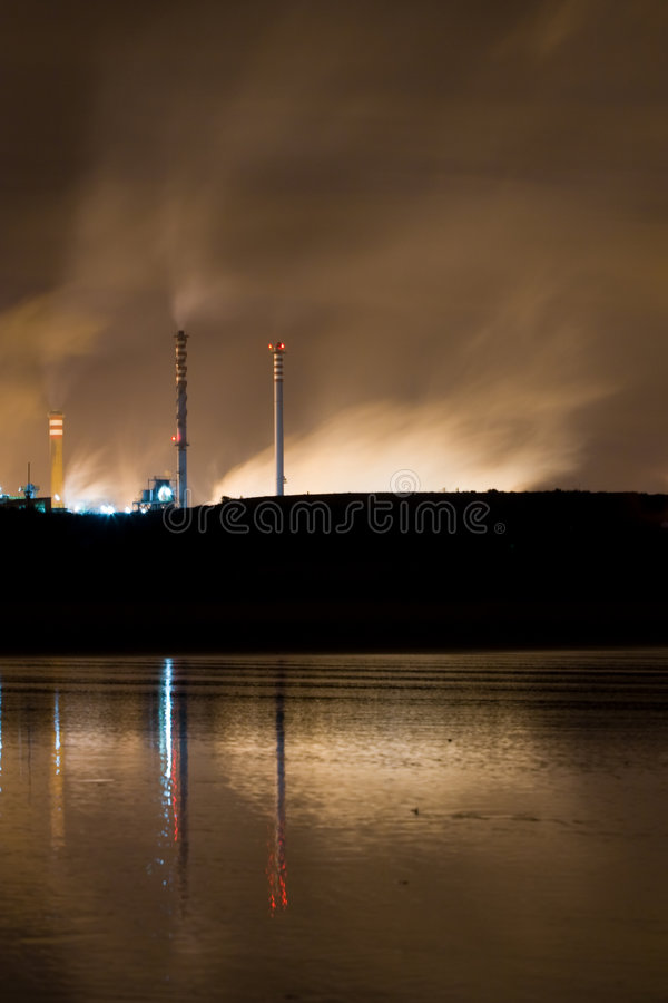 Nocturnal coastal industry stock photo