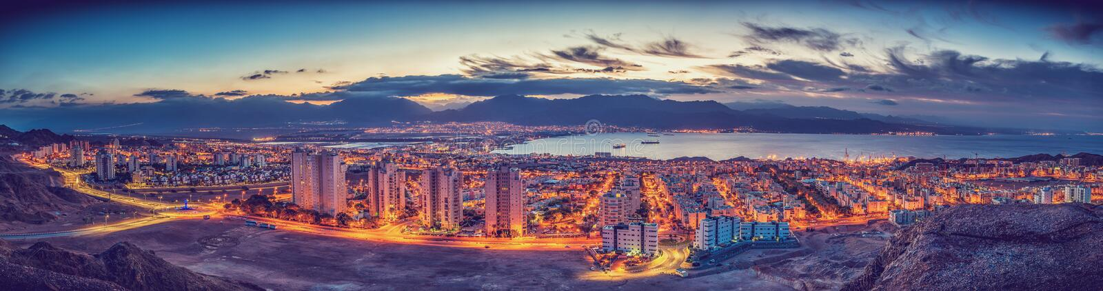 Nocturnal panorama. Eilat and Aqaba. Gulf of Aqaba, Red Sea. The nocturnal image was taken from the surrounding hills of Eilat city, Israel stock image