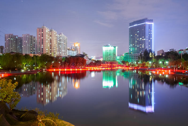 Nocturne view of the lake in the Yantan Park in Lanzhou (China) royalty free stock photo