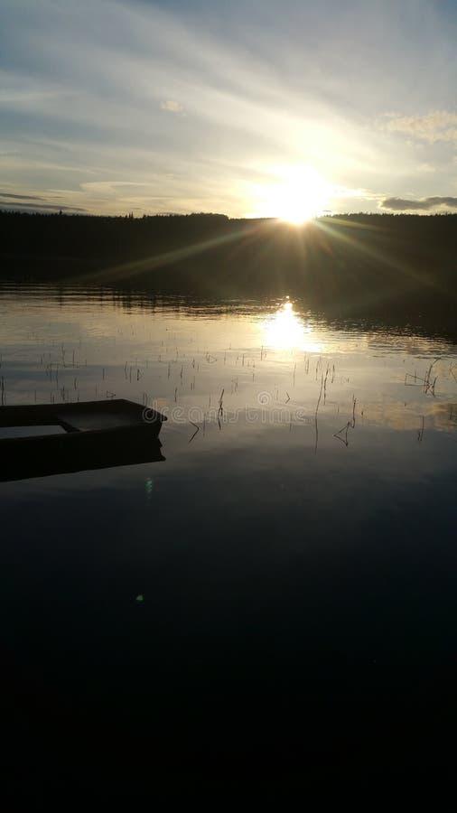 Nocy słońca nieba lata wody piękna szkodliwa harmonia fotografia royalty free
