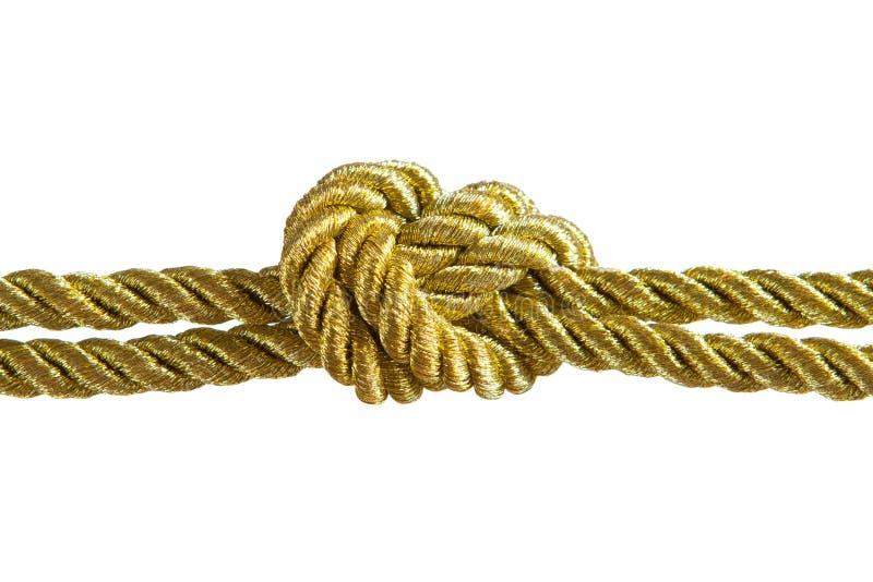 Nodo della corda dell'oro fotografie stock