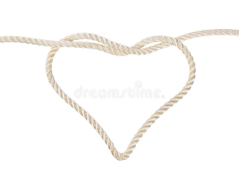 Nodo a forma di del cuore su una corda fotografia stock libera da diritti