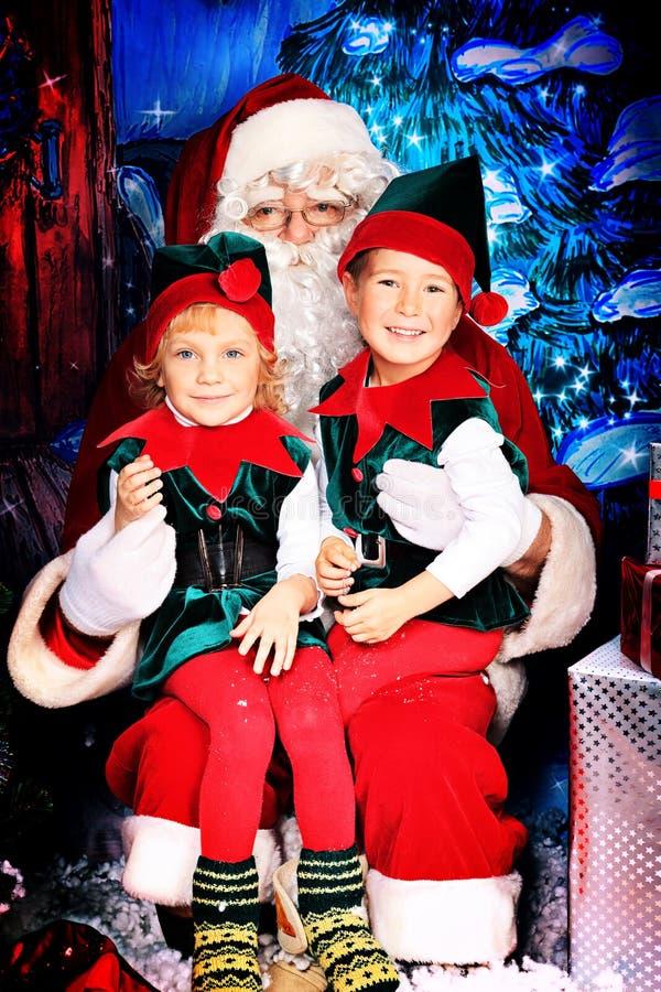 Noel ed elfi fotografia stock libera da diritti