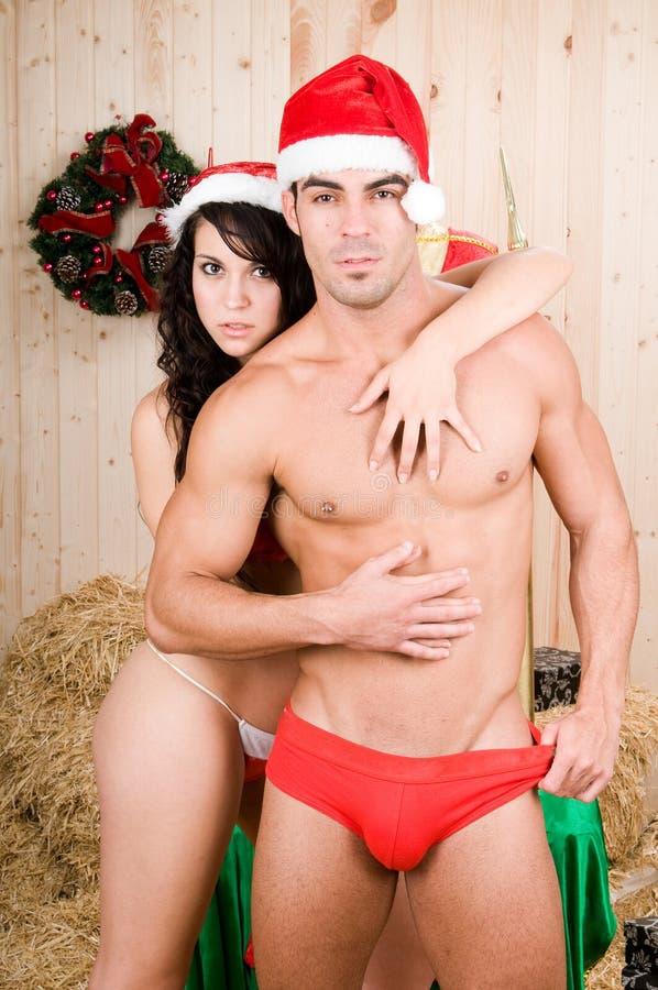 Noel o mujer de Claus con el hombre imágenes de archivo libres de regalías